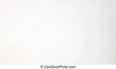 Handsome man smelling coffee against a white background