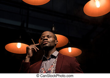 handsome man smoking cigar