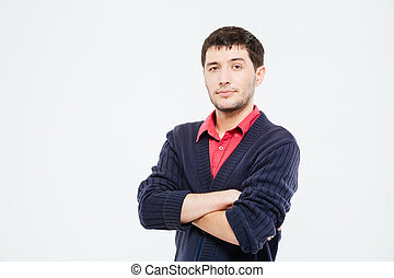 Handsome man standing with arms folded