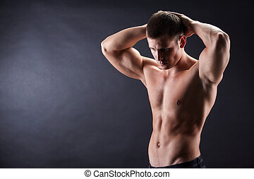 Handsome man - Image of shirtless man in jeans looking...