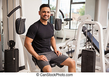 Handsome man taking a break at the gym - Attractive young...