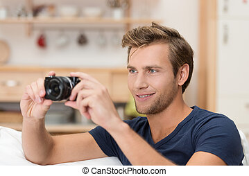 Handsome man taking a photograph