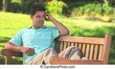 Handsome man talking on mobile