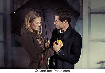 Handsome man talking to charming woman