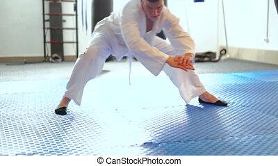 Handsome man training stretching legs