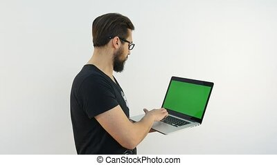 Handsome Man Typing on Laptop