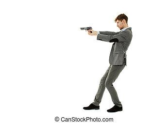 Handsome man using a gun