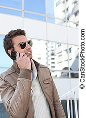 Handsome man using a phone