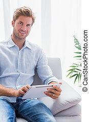 Handsome man using a tablet pc on h