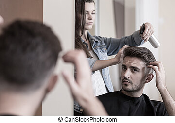 Handsome man visiting a hairdresser