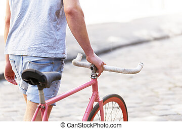 Handsome Man Walking With Bicycle