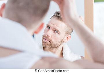 Handsome man watching himself - Image of handsome man...