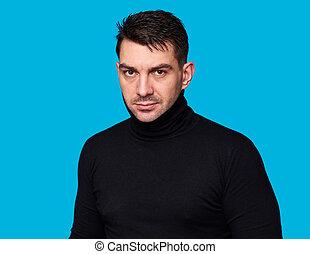 handsome man wearing black turtleneck. Isolated