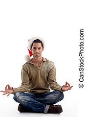 handsome man wearing christmas hat and doing meditation on...