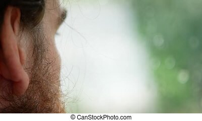 handsome man with a beard, side view, close-up