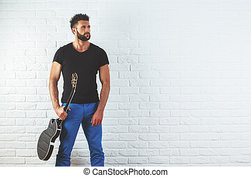 Handsome man with electric guitar - Portrait of handsome...