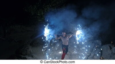 Handsome man with fire - Aerial view of handsome man doing...
