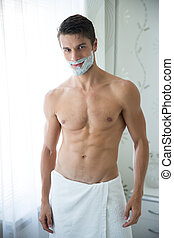 Handsome man with foam on face