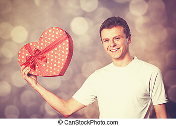 Handsome man with gift.