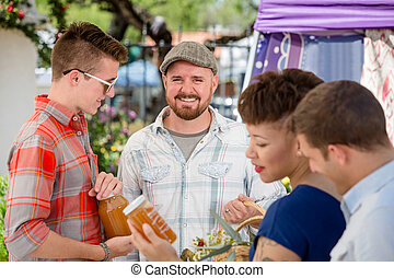 Handsome Man with Honey Vendor at Famers Market - Handsome...