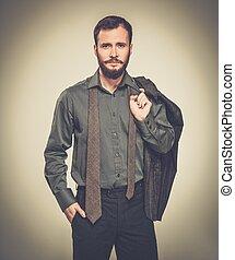 Handsome man with jacket over his shoulder