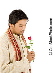 Handsome man with red rose