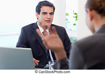 Handsome manager interviewing a female applicant