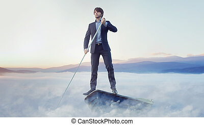 Handsome manager rowing in the boat