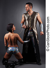 Handsome master keeps his sexual slave in chains - Image of...
