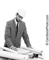 Handsome mature contractor drawing a building plan