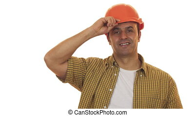 Handsome mature engineer wearing hardhat smiling confidently