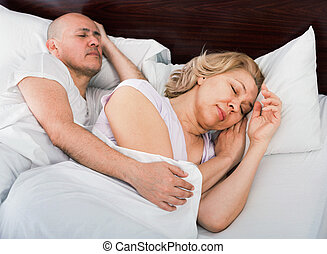 Handsome mature man and calm woman taking a nap