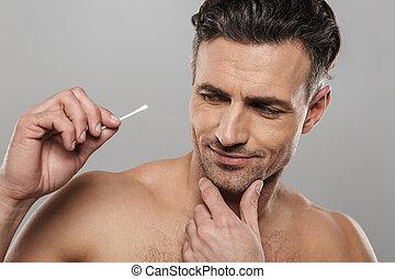 Handsome mature man holding cotton bud. - Image of handsome ...
