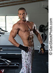 Flexing Muscles - Handsome Mature Man Standing Strong In The...
