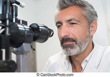 handsome mature scientist working