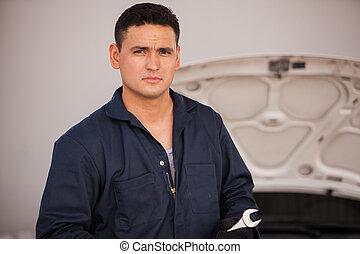 Handsome mechanic at an auto shop