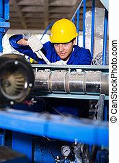 mechanic repairing machine with spanner