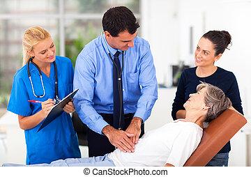 medical doctor examining senior patient
