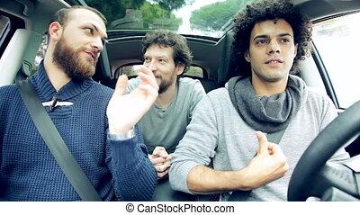 Handsome men having fun in car