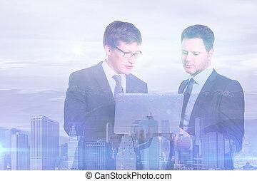 Handsome men using laptop