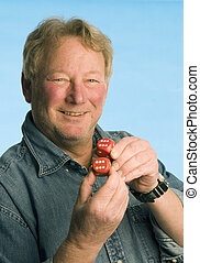 handsome middle age man holding dice