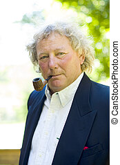 handsome middle age man pipe smoker portrait