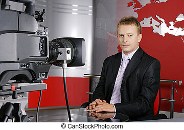 handsome middle age television news presenter - blond middle...