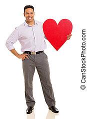 middle aged businessman holding red heart symbol - handsome...