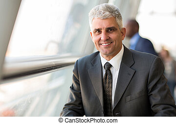 middle aged businessman in modern office