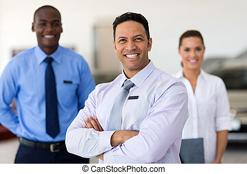 middle aged car salesman with colleagues