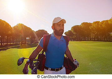 handsome middle eastern golf player at the course