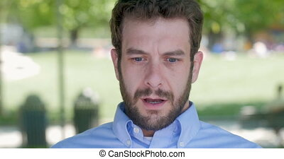 Handsome millennial man in 30s with beard surprised to hear...