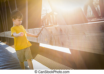 Handsome Mixed Race Boy Walking on Bridge
