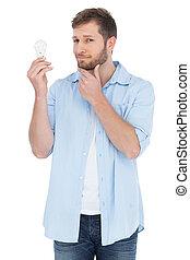 Handsome model holding a bulb